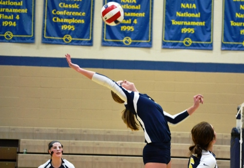 She leaps, she bends, she snacks the ball hard...an MMU volleyball player Wednesday night. The Mustangs routed SAU. What does this have to do with death? Read on, reader, read on.